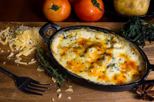 baked spinach & cheese with recipe on wood table