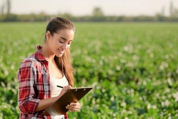Female farmer working in field Fotoväggar