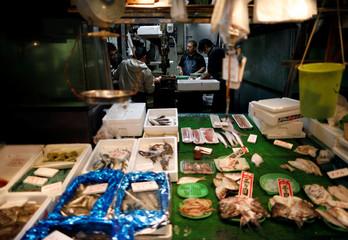 Vendors work inside a fresh fish shop at Yanagibashi Rengo Market in Fukuoka