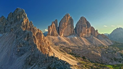 Wall Mural - Majestic aerial view of Tre Cime and mountain shelter, Dolomites