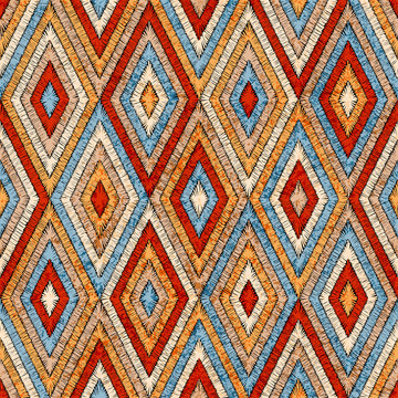 Embroidered seamless geometric pattern. Ornament for the carpet. Ethnic and tribal motifs. Vintage grunge texture. Colorful print of handmade. Orange, gray, black and blue colors. Vector art.