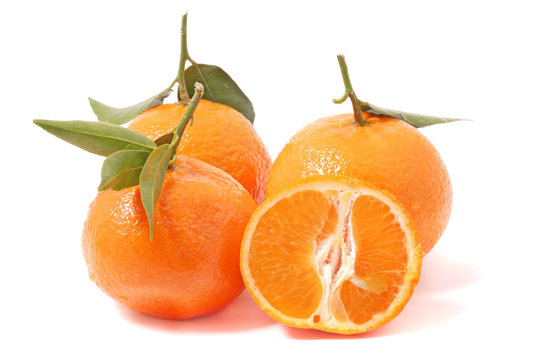 Orange mandarins with leaf isolated on white background. Healthy fruits, tangerines.