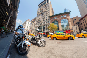 New York, USA - August 15, 2015: Fisheye lens picture of Police patrol motorcycles parked at the 5th Avenue.