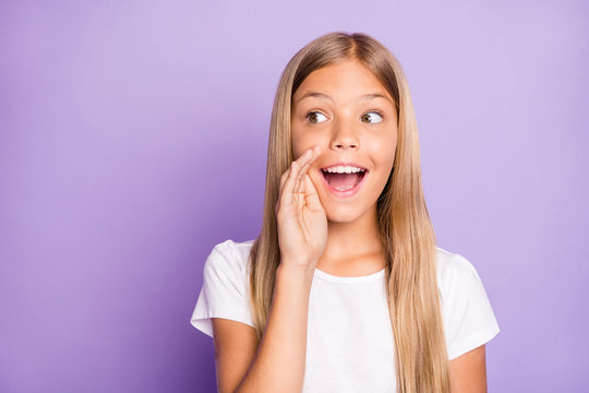 Close up photo of excited funky interested model child girl hold hand near mouth share confidential information tell rumors wear style clothes isolated over violet color background