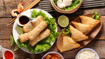 Fototapeta selection of asian food- spring roll, samosa, fried noodles, soup, rice and dumpling obraz