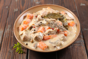Fototapete - blanquette de veau, french gastronomy- veal cooked with cream,carrot and herbs
