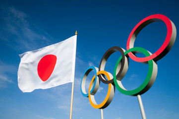 RIO DE JANEIRO - MARCH, 2016: A Japanese flag waves in front of Olympic Rings.