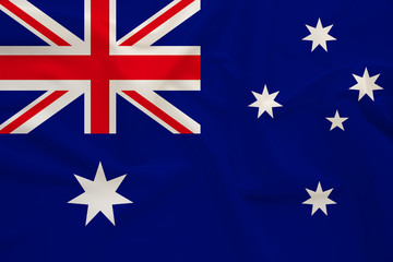 national flag of Australia on delicate silk with wind folds, travel concept, immigration, politics