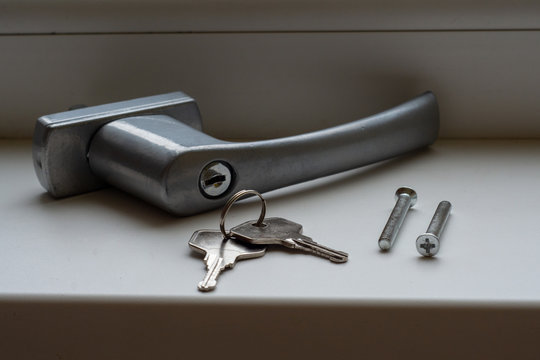 Window handle lock. Key locking window with key for kids safety. Window Restrictors in the home.