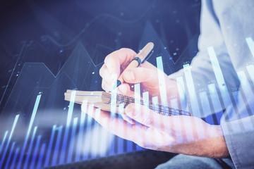 Double exposure hands with stock market chart.