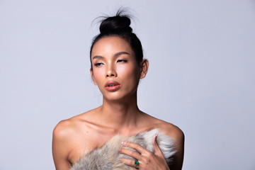 Unisex Transgender Model Fashion Young Asian Woman Thin black hair beautiful make up fashion held Fox Trail as cold weather. Studio Lighting white Background, collage group pack
