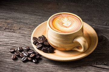 Still life photography : Coffee cup of latte art with coffee bean on old wood space