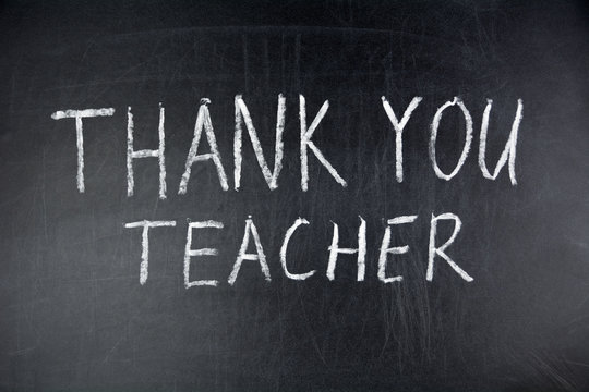Thank you teacher handwritten on a chalkboard