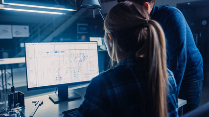 Engineer Working on Desktop Computer, Screen Showing CAD Software with Technical Blueprints, Her...
