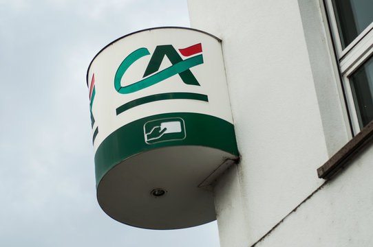 Mulhouse - France - 27 September 2019 - Closeup of Credit agricole logo on french bank agency in the street
