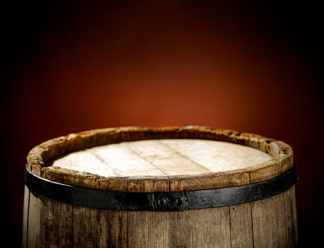 Wooden old retro barrel and mood brown blurred background