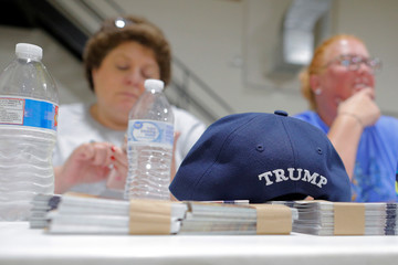 A hat embroidered with U.S. President Donald Trump's surname sits on a table at a leadership training session for local Republican Party officials and volunteers in Waukesha