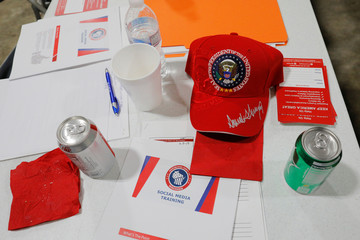 A hat embroidered with U.S. President Donald Trump's signature sits on table at a leadership training session for local Republican Party officials and volunteers in Waukesha