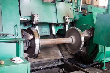 Rail wheelset in a lathe. Repair shop of railway cars