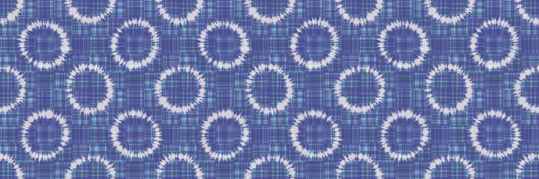 Polka dot ring tie dye seamless border pattern. Hand dyed effect wax batik circle. Spliced streaks of gradient dye gingham check background. Bleach resist blended texture geo effect ribbon trim edge