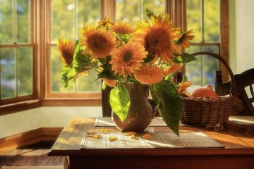 Still life with sunflowers in a vase on table