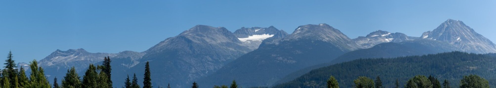 Whistler Mountain Panorama in British Columbia, Canada in the summer sun and blue sky looking at mountain range