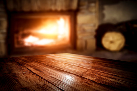 Wooden table and fireplace