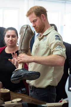 Britain's Prince Harry examines prosthetic leg at Princess Diana Orthopaedic Centre in Huambo