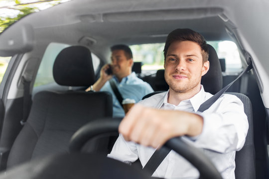 transport, vehicle and people concept - male driver driving car with passenger