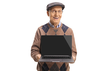 Senior gentleman holding a laptop computer and smiling