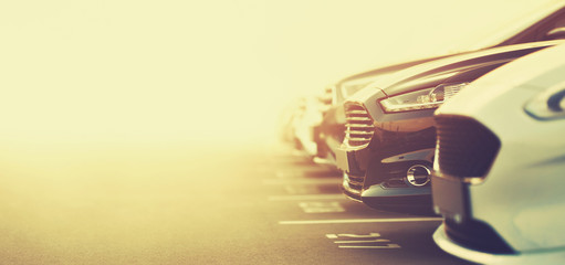 luxury cars on dealership parking in selective focus Wall mural
