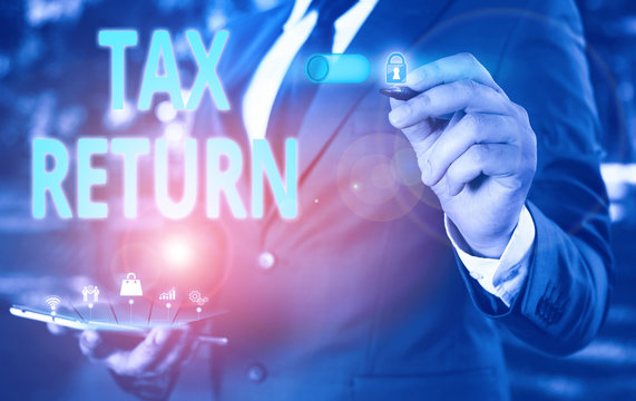 Text sign showing Tax Return. Business photo showcasing which taxpayer makes annual statement of income circumstances Male human wear formal work suit presenting presentation using smart device