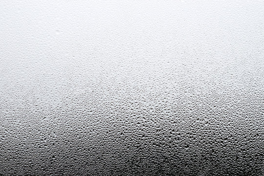 Steamy window background. Drops of condensate on the glass