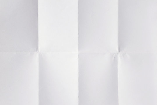 Blank white sheet of paper folded 3 times