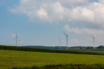Big windmills for wind power on the field