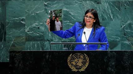 Venezuela's Vice President Rodriguez shows pictures as she addresses the 74th session of the United Nations General Assembly at U.N. headquarters in New York City, New York, U.S.