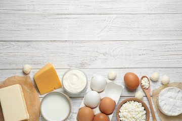 Fotobehang Zuivelproducten Different dairy products on white wooden table, flat lay. Space for text