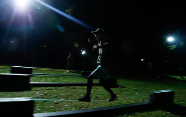 "A participant takes part in an extreme night run ""Bison race"" near the town of Logoisk"