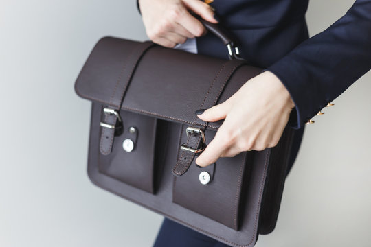 Office woman with leather briefcase