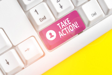 Writing note showing Take Action. Business concept for do something official or concerted to achieve aim with problem White pc keyboard with note paper above the white background
