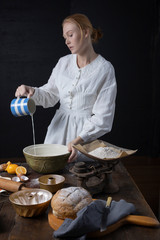 Victorian woman baking in a vintage kitchen
