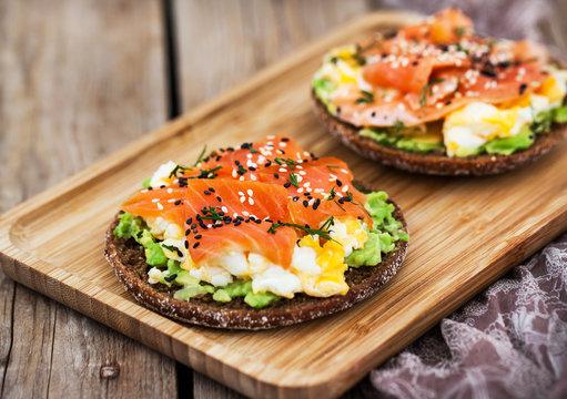 Smoked salmon, scrambled eggs and avocado  rye crisp toast