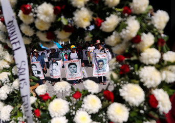 A wreath is seen as people participate in a march to mark the fifth year since the disappearance of the 43 students of the Ayotzinapa Teacher Training College, in Iguala, Guerrero