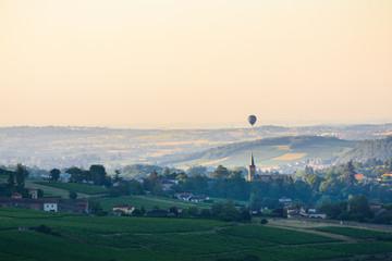 Village of Le Bois d'Oingt with a balloon flying, Beaujolais, France