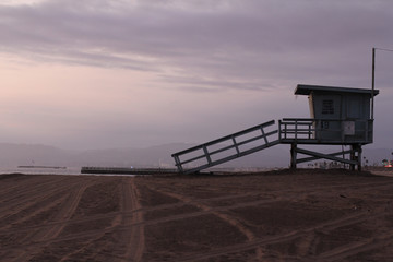 lifeguard tower purple sunset beach with american flag