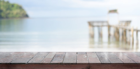 Empty rustic plank with beautiful tropical beach in the background