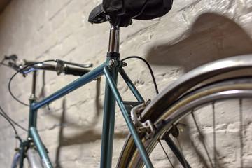 Aluminium Prints Bicycle Close up of a bicycle at white brick wall