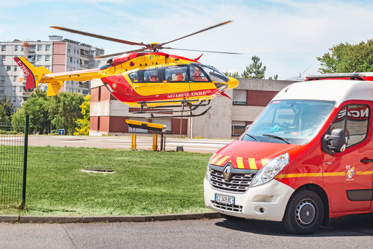 22 July 2019, Strasbourg, France: emergency helicopter and ambulance Truck are parked near the first aid Department in the hospital. Transport concept for medical personnel
