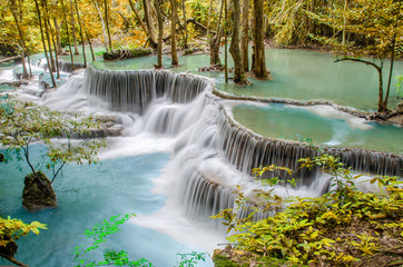 Tuinposter Bos rivier Travel to the beautiful waterfall in tropical rain forest, soft water of the stream in the natural park at Huai Mae Khamin Waterfall in Kanchanaburi, Thailand.