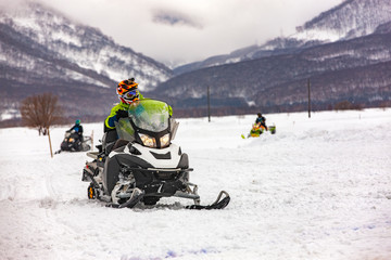 show on the holiday competition snowmobiles in Kamchatka